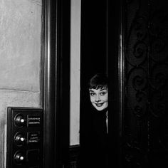 Audrey Hepburn in her apartment building in London, photographed by Walter Carone, 1951