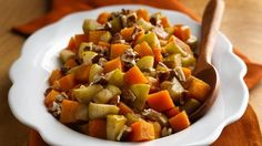 Combine fall flavors--squash, nuts, apples--then bake with sweet maple to bring out wonderful flavor.