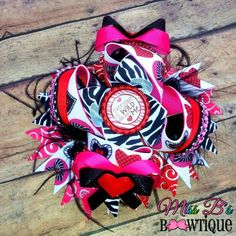 Valentines Day Hair Bow  Everyone is wild about me!  Custom order your bows today! www.facebook.com/missbsbowtique05 www.etsy.com/missbsbowtique05
