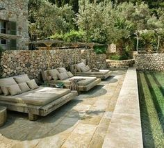 Gorgeous Italian countryside backyard with cozy outdoor lounges by the pool.