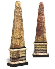 A PAIR OF GEORGE III BLUE-JOHN AND ALABASTER OBELISKS  CIRCA 1780-1800  Each with a flattened body on a rectangular slate plinth, one repaired  Each 17¼ in. (44 cm.) high (2)