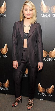 DIANNA AGRON in a tailored jacket covering her bra top and high-waisted pants at a press night for the play McQueen (about late designer Alexander McQueen), in which she stars, in London.