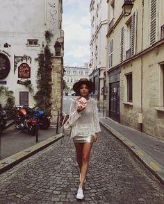 Negin Mirsalehi with a meringue in Paris
