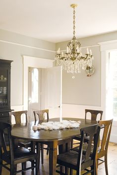 crystal chandy contrasts with dark wood dining set