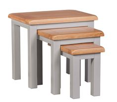 Set of 3 nest tables with oak table tops.