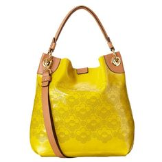 Orla Kiely soft patent leather Burdock bag in lichen.  Slouchy bucket-style with popper fastening to close. Characteristics include detachable strap so that the bag can be worn across the body and punched floral detailing/Orla Kiely logo to front. Inside detailing include small zip, key chain and mobile pockets.