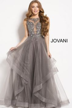 3b9c6e4c60a Style 48739 from Jovani is a sleeveless prom gown with a beaded illusion  bodice and a sheer layered tulle skirt.