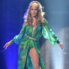 The look was, of course, by Versus Versace, and all five of the singer's on-stage costumes were designed by the Italian fashion house.