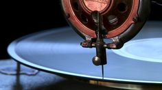 stock-footage-close-up-of-needle-drop-on-antique-turntable.jpg