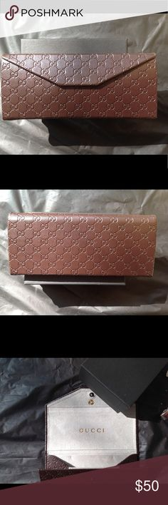 Gucci Brown Folding Case Gucci brown leather folding case with the gray inside silk smooth and very soft to the touch. Trifold and very protective for prescription or sunglasses. Gucci Accessories Glasses
