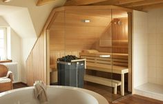 Bathroom sauna that fits under slope roof, with glass door. From klafs.com