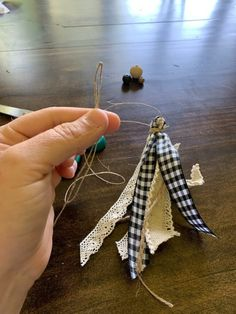 Jul 2019 - Learn how to makea simple yet adorable little wood bead tassel to use as embelishments for your exsisting decor. All you need is ribbon, beads and twine. Wood Bead Garland, Beaded Garland, Beaded Ornaments, Rag Garland, Fabric Garland, Dollar Store Crafts, Crafts To Sell, Diy Crafts, Mery Chrismas