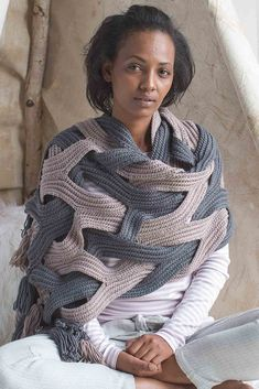 This intricate wrap will help you indulge in relaxation at home. The Indulgent Wrap by Alla Koval is crocheted in one piece and then braided together and seamed. Get the pattern, and tons more elegant yet cozy crochet patterns in Interweave Crochet, Winter 2018!