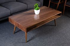Our minimalist coffee table is a great addition to any room! It has a great mid-century modern design, offers clean lines and blends with anyones décor. We have priced out our most common sizes but if you dont see what you are looking for just ask! Image 1-2 - Solid Walnut 24x48 - Shown with gold dipped legs. If you do not want the gold dip let us know! Image 3 - Available wood choices. Select a size and Material that fits your space. Dimensions available: 16x36x18 16x42x18 18x42x18…
