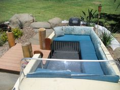 A boat-loving homeowner made a big design statement in his backyard by adapting an old unwanted boat into bench seating beside his pool.