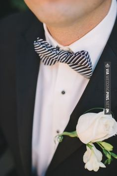 Neat - black and white striped bow tie for the Groom Photography by Mango Studios / , Floral Design by My Elegant Baskets / | CHECK OUT MORE GREAT BLACK AND WHITE WEDDING IDEAS AT WEDDINGPINS.NET | #weddings #wedding #blackandwhitewedding #blackandwhiteweddingphotos #events #forweddings #iloveweddings #blackandwhite #romance #vintage #blackwedding #planners #whitewedding #ceremonyphotos #weddingphotos #weddingpictures
