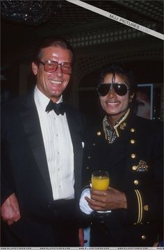 MJ and James Bond actor Roger Moore at the New York Metropolitan Museum of Natural History February 7 1984