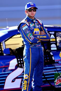 Chase Elliott Photos Photos - Chase Elliott, driver of the #24 NAPA Auto Parts Chevrolet, stands on the grid prior to qualifying for the NASCAR Sprint Cup Series Hellmann's 500 at Talladega Superspeedway on October 22, 2016 in Talladega, Alabama. - Talladega Superspeedway - Day 2