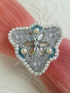 Check out this item in my Etsy shop https://www.etsy.com/nz/listing/514772669/silver-shiny-flower-hair-tie-hair