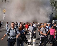 Pedestrians scramble for safety in front of City Hall as the first World Trade Center tower collapses after being hit by an aircraft in New York Tuesday, Sept. 11, 2001. (AP Photo/Paul Hawthorne) Photo: PAUL HAWTHORNE