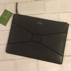 "Kate Spade Black Envelope Clutch Pebble Leather Kate Spade Black Envelope Clutch Pebble Leather Measurements : 11"" W x 8"" H. Price is Firm Unless Bundled. 10% Off 2 Item 15% Off 3 Items or More kate spade Bags Clutches & Wristlets"