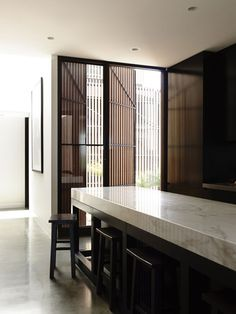 Thick Marble countertop-black and white kitchen_Torquay House by Wolveridge