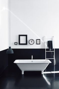 Everything is in it's place in this black and white bathroom.