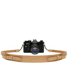 """Universal+Camera+Strap+designed+for+DSLR+and+35mm+cameras.+Constructed+of+7oz+natural+vegetable+tanned+leather+with+adjustable+straps+and+solid+brass+hardware.+Strap+is+attached+to+camera+with+waxed+cotton+cord+loops+which+will+not+scratch+or+mark+your+camera.  FEATURES  Adjustable+42""""+to+5..."""
