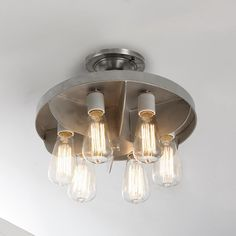 Reproduction Industrial Engine Fan Ceiling LightInspired by a vintage airplane engine cooling fan, this nostalgic design adds enduring appeal. Galvanized gray with 6 medium base sockets, it can be hung close to the ceiling as a flush mount or hung down as a mini chandelier over a small table. Add some of our vintage Edison bulbs for even more charm.
