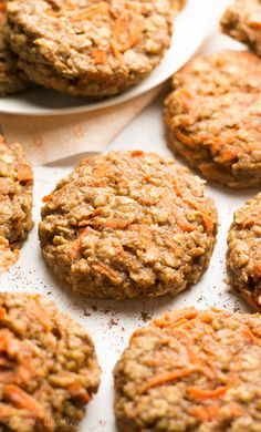 Healthy Carrot Cake Oatmeal Breakfast Cookies -- only 74 calories, but they don't taste healthy at all! You'll never need another breakfast cookie recipe again!