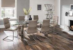 Santorini Extending Dining Table and Chairs #dining #glasstable #leather #roomscene http://www.cookesfurniture.co.uk/santorini-extending-dining-table-and-6-chairs/p3027