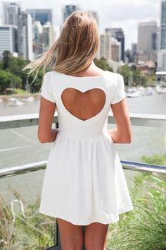 I am obsessed with the heart shape back of this dress. It's perfect!