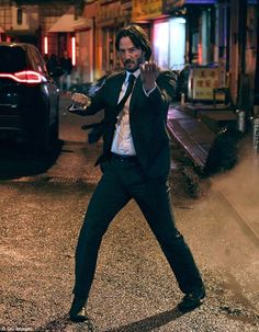 Action hero: Keanu ♡♥ Reeves was back on the set of John Wick 2 on Monday night filming action scene...