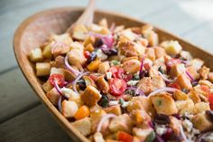 High up on the list of dishes that impress in both presentation and flavor yet require very little effort is panzanella. This bread salad — fashioned from day-old bread, along with a slew of ingredients including tomatoes, herbs, and dressing — is a summer meal that can be stretched to feed many.