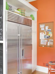 "Faux Built-In ""A false wall built around a freestanding refrigerator gives it the look of an expensive built-in. A shelf above the fridge provides storage and display space for decorative dishware and cookbooks. Chalkboard paint transforms the outer edge of the unit into a handy message center."""