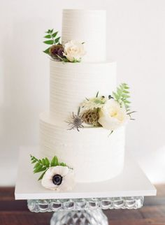 Textured white buttercream cake with fresh florals, by Earth And Sugar