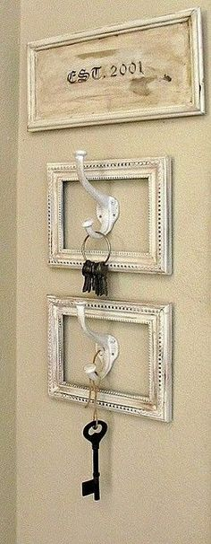 Rustic key holders at the entrance door. White washed frames, hooks and then a cute framed art piece of the year you moved in.
