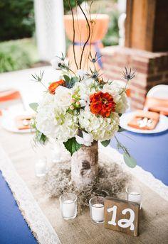 Hydrangeas, zinnias, celosia, cotton, eucalyptus centerpieces, bright blue tablecloth // Casey & Kristin