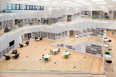 "Dalarna University Media Library, Sweden. Designed by the Danish architecture studio ADEPT based in Copenhagen. The library is envisioned as a ""spiral of knowledge"". The building is on the shortlist of the ""World Architecture Festival 2014"". I love the white shelving which brightens the interior. EA."