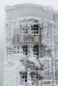 An old Chicago warehouse catches on fire, but it's so cold that the water from the fire hoses freezes almost instantly, creating a beautiful, icy after effect.   After the Warehouse Fire by metroblossom, via Flickr