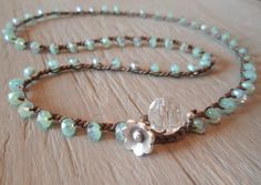 These faceted czech beads are gorgeous - transparent seafoam green with an aurora borealis iridescent finish, they promote a glow that is so remarkable :) Tightly crocheted on brown nylon cord with a rustic Thai silver flower that dangles from the loop closure. Very sweet & shabby!    Wear as a necklace with the closure in the front or wrap 3x around your wrist for a pretty wrap bracelet :) Its the perfect length to wrap twice around your ankle too :) Also looks GREAT with some of my…