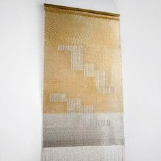 Hand woven wall tapestries. The designs are informed by native american, traditional navajo tapestries depicting mountains & time lines.  gold metallic threads, bronze wire, waxed linen, handspun cotton fringe, silver metallic thread, silver plated wire…
