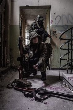 wanderers with guns. inside ruined building. Stalkers