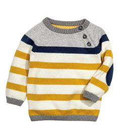 H&M $12.99 Fine-knit cotton sweater with raglan sleeves, buttons at front of one shoulder, and contrasting elbow patches.