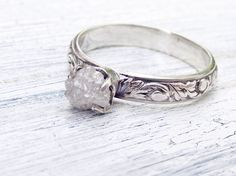 Like the Rustic Sterling but needs tapering and stone needs inset... stone also needs more clarity