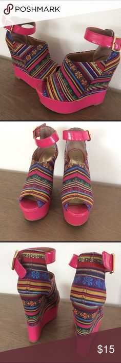 Hot pink tribal print platform shoes. Bright pink platforms look amazing with frayed jeans. Side ankle straps and a 1.5 inch platform make these shoes stand out. Bakers Shoes Platforms