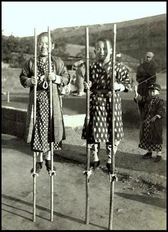 HAVE STILTS, WILL TRAVEL -- Ca.1915-23 silver print.
