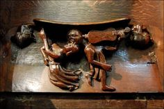 Chichester Cathedral - Medieval carving - choir stall seat or misericord shows a couple kissing