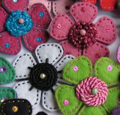 Felted flowers..I couldn't find a pattern; but these flowers should be easy to figure out. Doesn't embroidery look pretty on felt?!