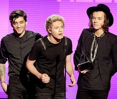 """"""" Zayn Malik, Niall Horan and Harry Styles accept the Favorite Pop/Rock Album award for 'Midnight Memories' onstage at the 2014 American Music Awards """""""